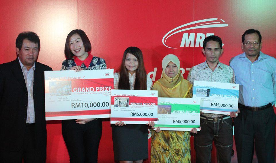 WINNER: MRT Corp CEO Dato' Azhar Abdul Hamid (left) with winners (from left)Ms Angeline Tu Sung Ing, Ms Yvonne Tan Eng Yen, Cik Atiqah Abdul Aziz and Encik Azmil Mohamad. With them is MMC-Gamuda KVMRT (PDP) Sdn Bhd Director Dato' Azmi Mat Nor.