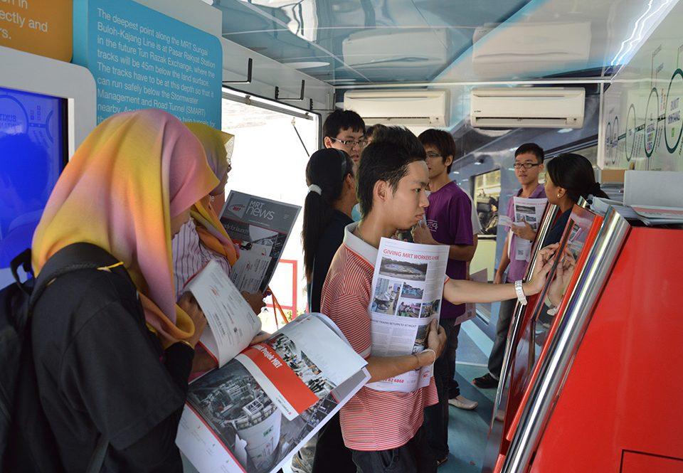 GETTING INFORMED: Students learning about the MRT Sungai Buloh-Kajang Line inside the MRT Information Truck.