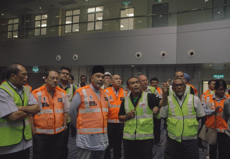 CLEAR UNDERSTANDING: MRT Corp Signalling & Train Control Head, Encik Mahdzir Ahmad (fourth from left, lime vest) explaining to Land Public Transport Commission (SPAD) Chairman, Tan Sri Dato' Seri Dr Syed Hamid Syed Jaafar Albar (third from left, orange vest) about the signalling systems inside the MRT Operations Control Centre.