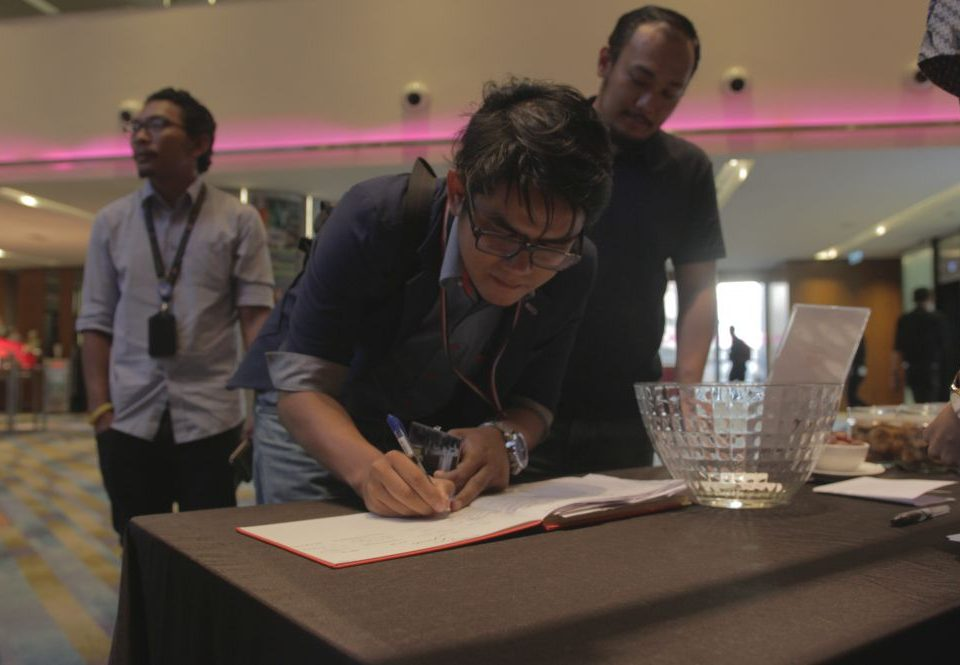 REGISTERATION: Guests of the Media Iftar taking turns to sign the guest book upon their arrival.