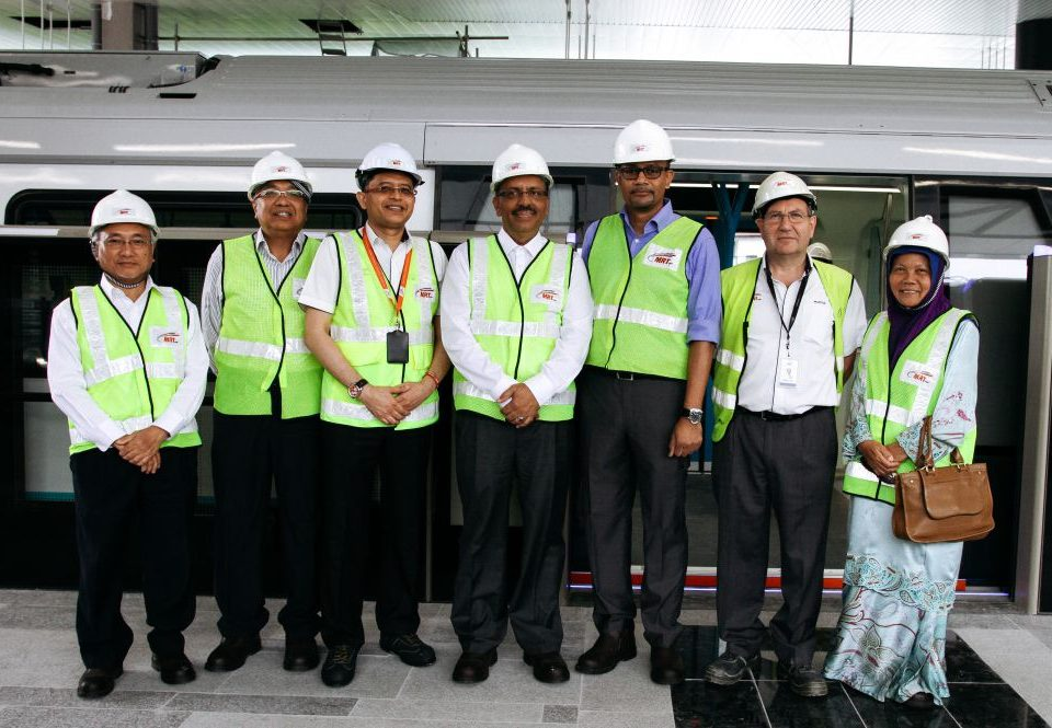 ACHIEVEMENT UNLOCKED: A group photo of the Board of Directors, Mass Rapid Transit Corporation Sdn Bhd (MRT Corp) with MRT Sungai Buloh-Kajang (SBK) Line Project Director Mr Marcus Karakashian (second from right) after the ride on the MRT train. They are (from left) Datuk Dr Ir Abdul Latif Mohd Som, Datuk Che Mokhtar Che Ali, Dato' Sri Shahril Mokhtar, Tan Sri Dr Ali Hamsa, Encik Zubir Zahid and Dato' Sutinah Sutan.