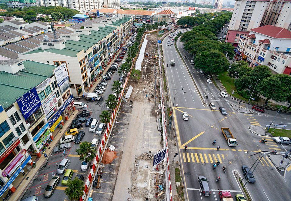 View facing south-bound of the site of the future Metro Prima Station with site clearing, piloting for underground services, soil investigation works and welding of gas pipe in progress.