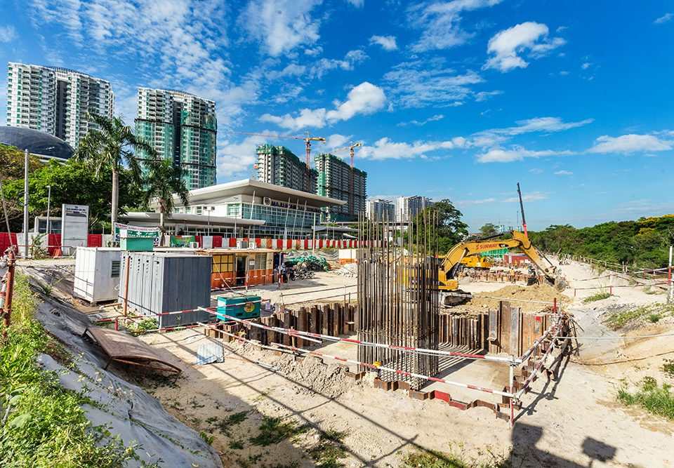 View of MRT construction works in front of the Muhibbah Showroom at Prima Damansara with bored piling and pile cap construction in progress.