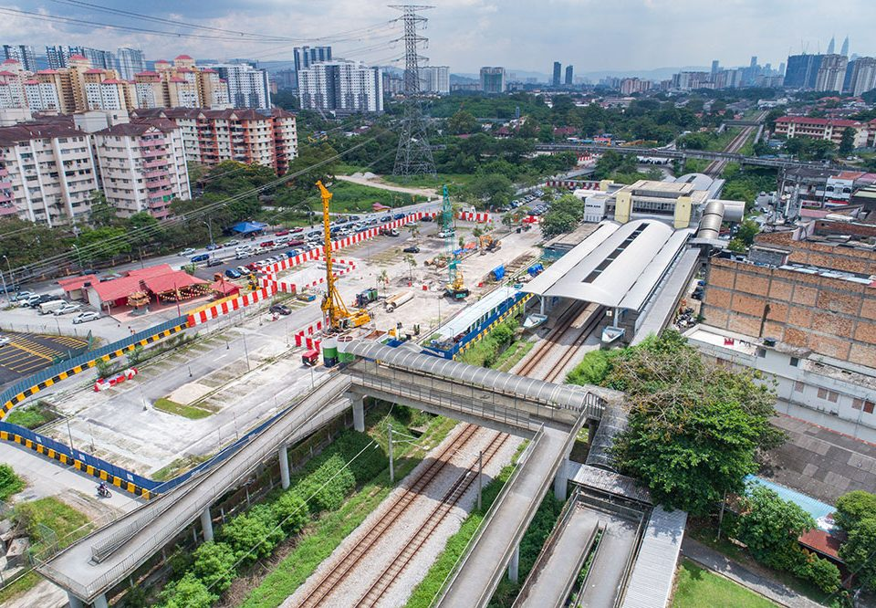 View of construction work for the future Kampung Batu MRT Station in the Kampung Batu KTM Station car park, with the completed replacement carparks behind.