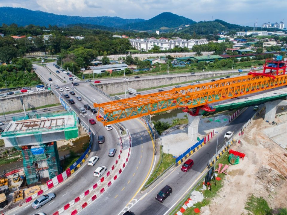 Erection of segmental box girder for long span crossing No 1, near the ramp to Sungai Buloh Toll Plaza.